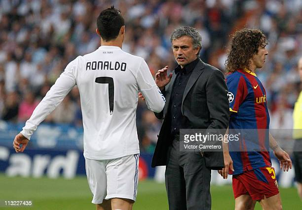 Head coach Jose Mourinho of Real Madrid gives instructions to Cristiano Ronaldo during the UEFA Champions League Semi Final first leg match between...