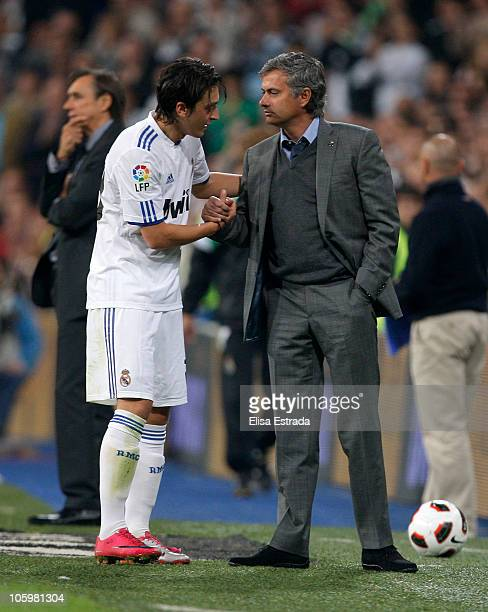 Head coach Jose Mourinho of Real Madrid greats Mezut Ozil during the La Liga match between Real Madrid and Racing Santander at Estadio Santiago...