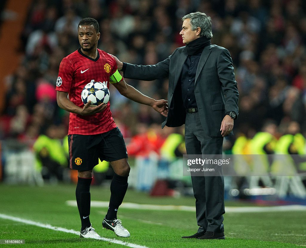 Head coach Jose Mourinho (R) of Real Madrid greats Patrice Evra of Manchester United during the UEFA Champions League Round of 16 first leg match between Real Madrid and Manchester United at Estadio Santiago Bernabeu on February 13, 2013 in Madrid, Spain.