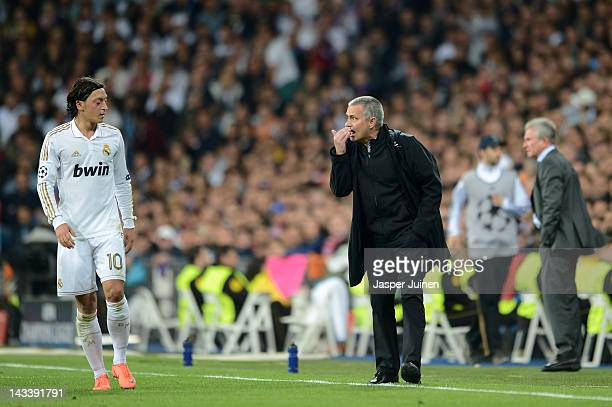 Head Coach Jose Mourinho of Real Madrid has words with Mesut Ozil of Real Madrid during the UEFA Champions League Semi Final second leg between Real...