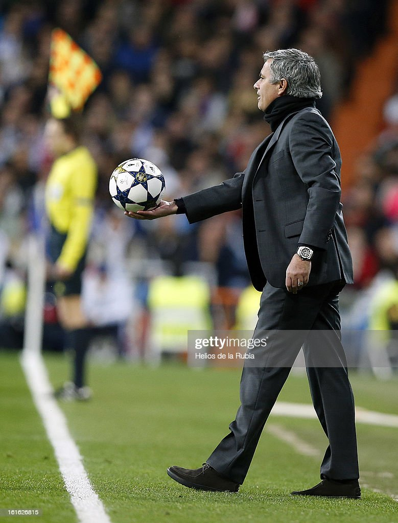 Head Coach Jose Mourinho of Real Madrid holds the ball during the UEFA Champions League Round of 16 first leg match between Real Madrid and Manchester United at Estadio Santiago Bernabeu on February 13, 2013 in Madrid, Spain.