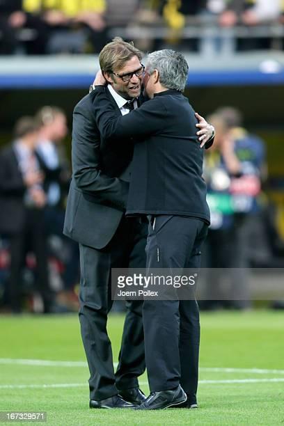 Head coach Jose Mourinho of Real Madrid hugs Head Coach Jurgen Klopp of Borussia Dortmund ahead of the UEFA Champions League semi final first leg...