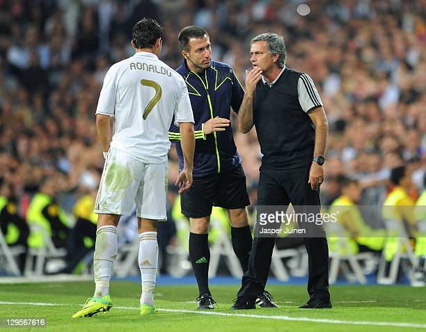 Head coach Jose Mourinho of Real Madrid instructs Cristiano Ronaldo during the UEFA Champions League group D match between Real Madrid and Olympique...
