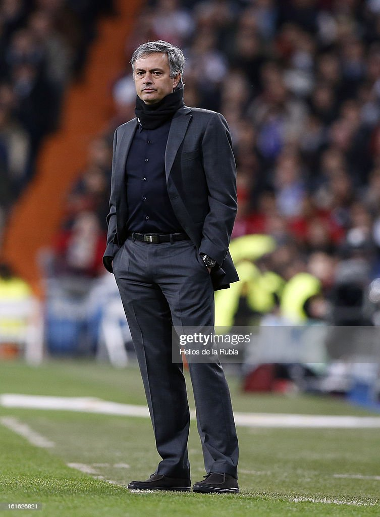 Head Coach Jose Mourinho of Real Madrid look on during the UEFA Champions League Round of 16 first leg match between Real Madrid and Manchester United at Estadio Santiago Bernabeu on February 13, 2013 in Madrid, Spain.