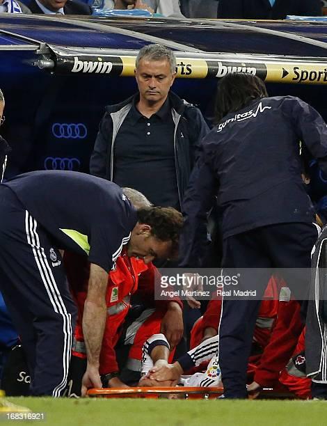 Head coach Jose Mourinho of Real Madrid looks as Mesut Ozil lies injured during the La Liga match between Real Madrid and Malaga at Estadio Santiago...