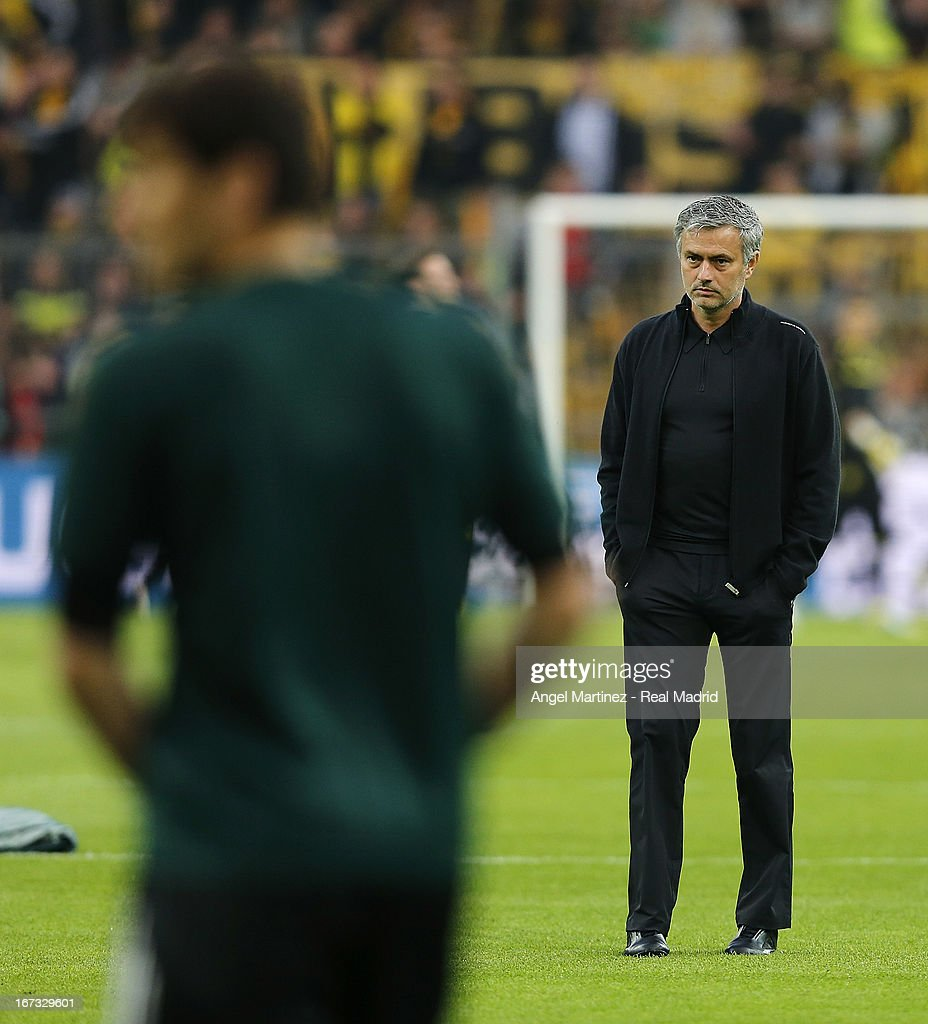 Head coach Jose Mourinho (R) of Real Madrid looks on as goalkeeper Iker Casillas warms up before the UEFA Champions League Semi Final first leg match between Borussia Dortmund and Real Madrid at Signal Iduna Park on April 24, 2013 in Dortmund, Germany.