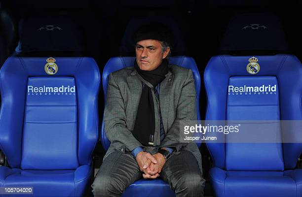 Head coach Jose Mourinho of Real Madrid looks on while seated on the bench prior to the start of the UEFA Champions League group G match between Real...