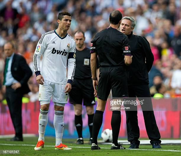 Head coach Jose Mourinho of Real Madrid reacts to referee Alvarez Izquierdo as Cristiano Ronaldo looks on during the la Liga match between Real...