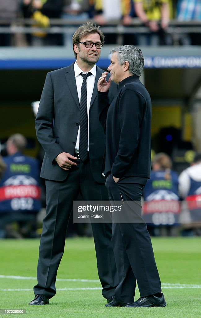 Head coach Jose Mourinho of Real Madrid speaks to Head Coach Jurgen Klopp of Borussia Dortmund ahead of the UEFA Champions League semi final first leg match between Borussia Dortmund and Real Madrid at Signal Iduna Park on April 24, 2013 in Dortmund, Germany.