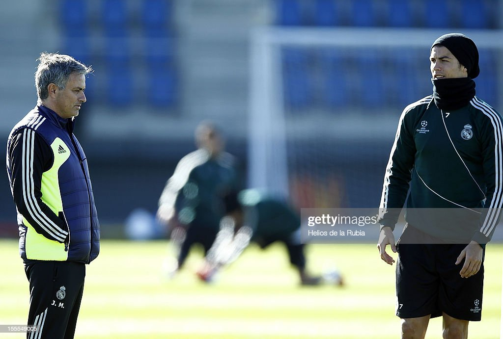 Head coach Jose Mourinho (L) of Real Madrid talks with <a gi-track='captionPersonalityLinkClicked' href=/galleries/search?phrase=Cristiano+Ronaldo+-+Soccer+Player&family=editorial&specificpeople=162689 ng-click='$event.stopPropagation()'>Cristiano Ronaldo</a> during a training session ahead of their UEFA Champions League group stage match against Borussia Dortmund at Valdebebas training ground on November 5, 2012 in Madrid, Spain.