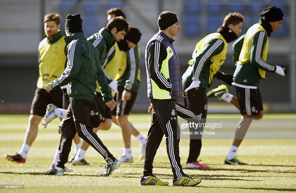 Head coach Jose Mourinho (C) of Real Madrid walks amid his players during a training session ahead of the UEFA Champions League match between Real Madrid CF and Manchester United at the Valdebebas training ground on February 12, 2013 in Madrid, Spain.