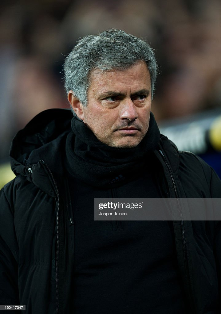 Head coach Jose Mourinho of Real Madrid walks to his team's bench during the Copa del Rey semi final first leg match between Real Madrid CF and FC Barcelona at the Estadio Santiago Bernabeu on January 30, 2013 in Madrid, Spain.
