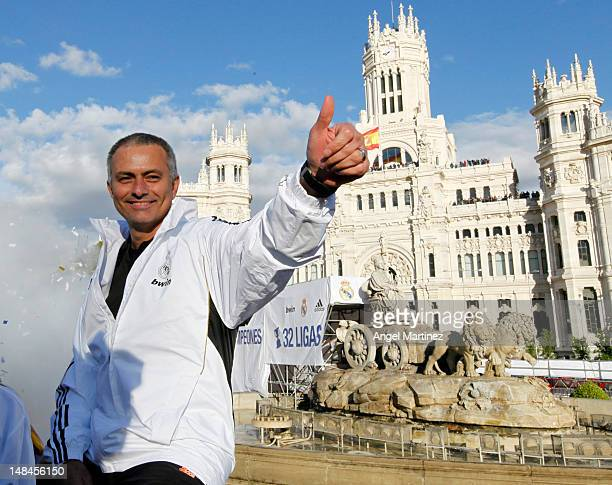 Head coach Jose Mourinho of Real Madrid waves during their victory parade at Plaza de Cibeles on May 3 in Madrid Spain