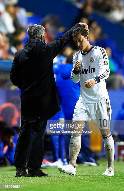 Head Coach Jose Mourinho reacts to Mesut Ozil after substituting him during the La Liga match between Levante UD and Real Madrid at Ciutat de...
