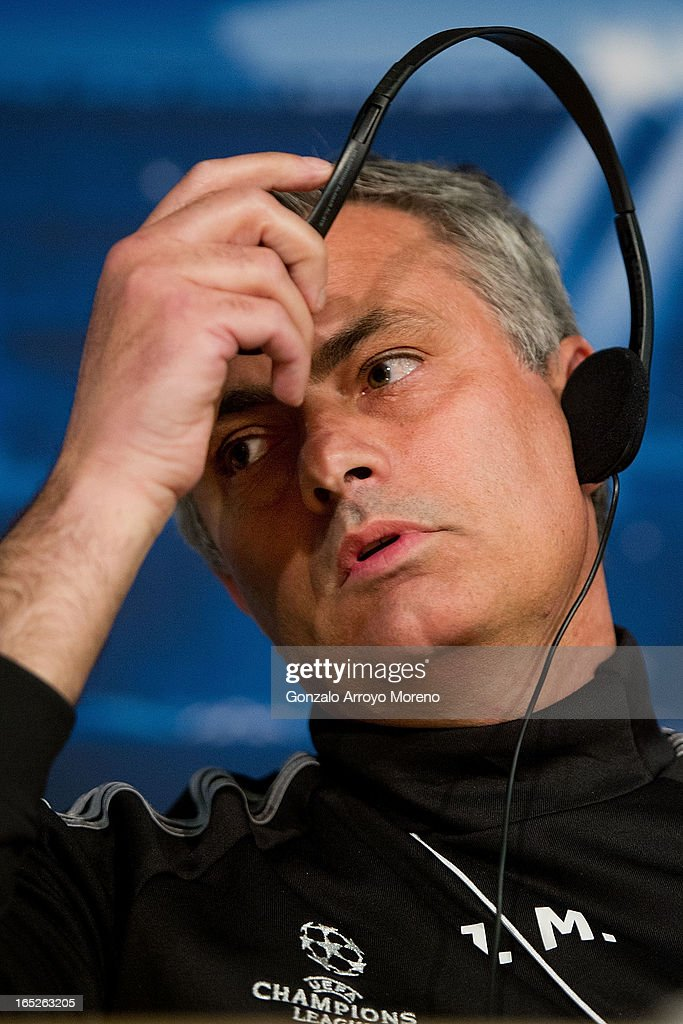 Head coach Jose Mourinho takes off his headphones during a press conference ahead of the UEFA Champions League Quarterfinal match between Real Madrid and Galatasaray AS at Santiago Bernabeu Stadium on April 2, 2013 in Madrid, Spain.