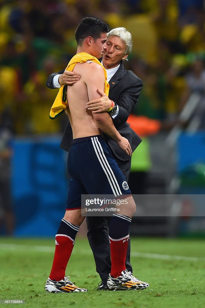 Head coach <a gi-track='captionPersonalityLinkClicked' href=/galleries/search?phrase=Jose+Pekerman&family=editorial&specificpeople=242856 ng-click='$event.stopPropagation()'>Jose Pekerman</a> of Colombia consoles <a gi-track='captionPersonalityLinkClicked' href=/galleries/search?phrase=James+Rodriguez&family=editorial&specificpeople=4422074 ng-click='$event.stopPropagation()'>James Rodriguez</a> after being defeated by Brazil 2-1 during the 2014 FIFA World Cup Brazil Quarter Final match between Brazil and Colombia at Castelao on July 4, 2014 in Fortaleza, Brazil.
