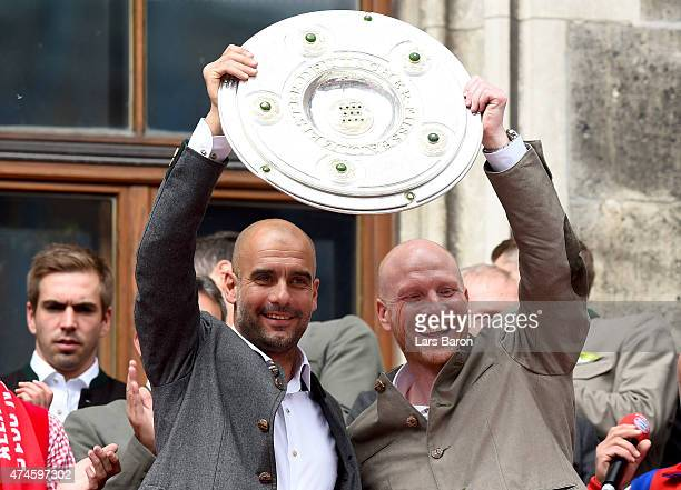 Head coach Josep Guardiola and manager Matthias Sammer lift the trophy and celebrate winning the Bundesliga at Marienplatz on May 24 2015 in Munich...