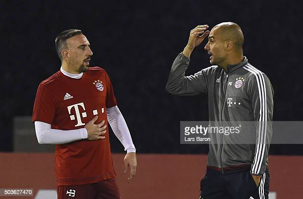 Head coach Josep Guardiola argues with Franck Ribery during a training session at day one of the Bayern Muenchen training camp at Aspire Academy on...