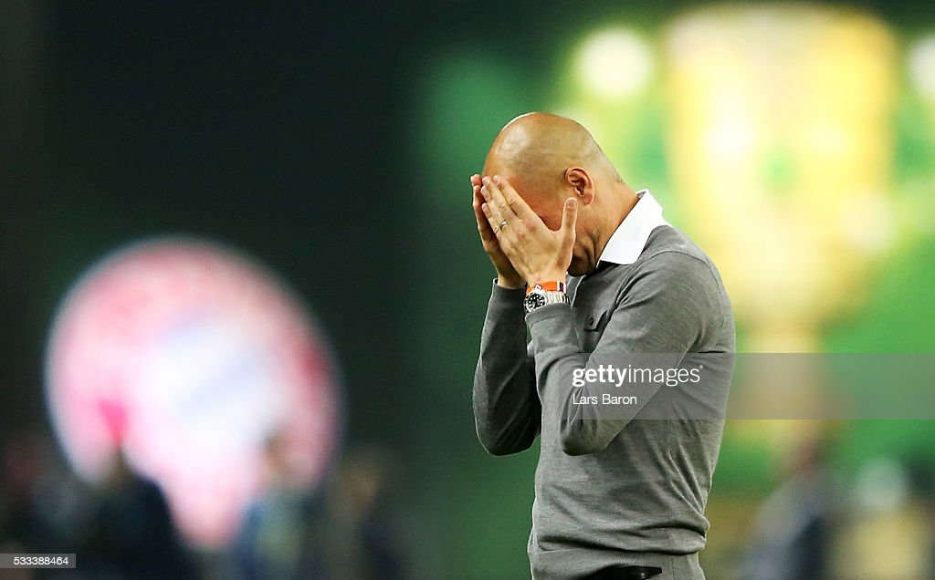 Head coach Josep Guardiola cries after winning the DFB Cup Final 2016 between Bayern Muenchen and Borussia Dortmund at Olympiastadion on May 21, 2016 in Berlin, Germany.