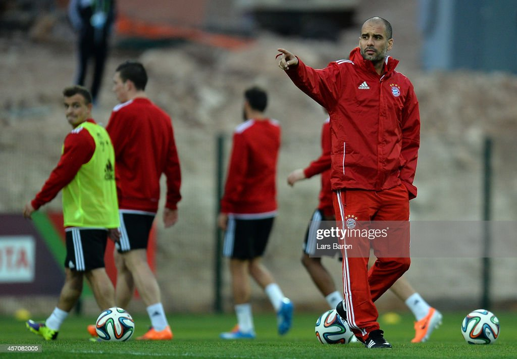HEad coach <a gi-track='captionPersonalityLinkClicked' href=/galleries/search?phrase=Josep+Guardiola&family=editorial&specificpeople=2088964 ng-click='$event.stopPropagation()'>Josep Guardiola</a> gestures during a Bayern Muenchen training session for the FIFA Club World Cup next to Agadir Stadium on December 16, 2013 in Agadir, Morocco.