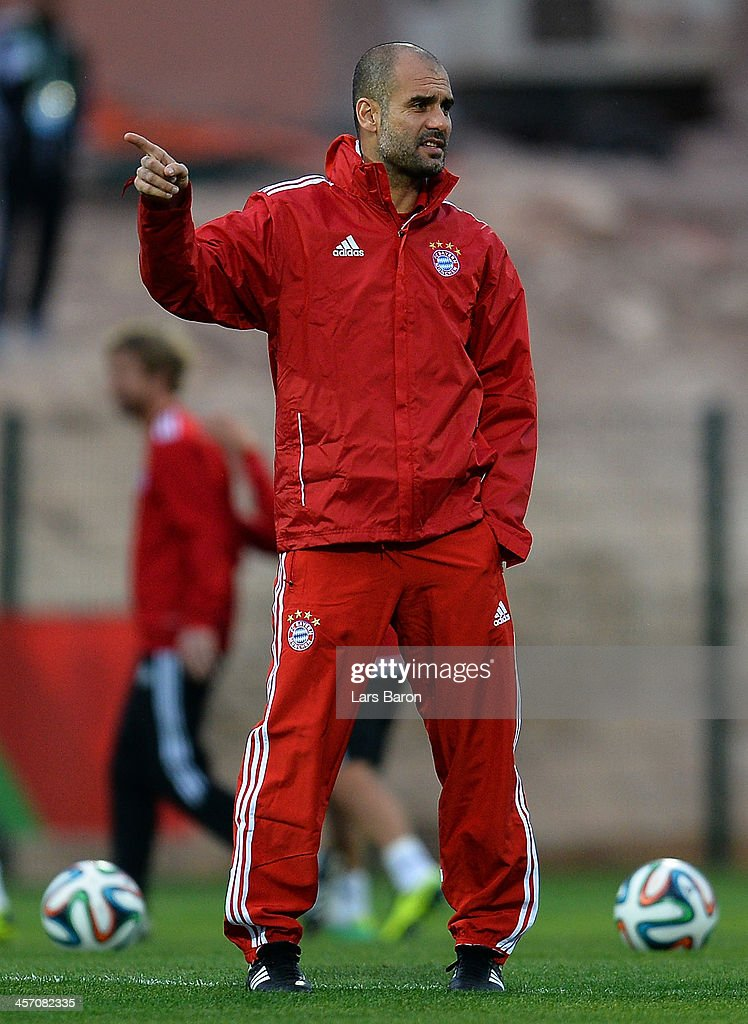 HEad coach Josep Guardiola gestures during a Bayern Muenchen training session for the FIFA Club World Cup next to Agadir Stadium on December 16, 2013 in Agadir, Morocco.