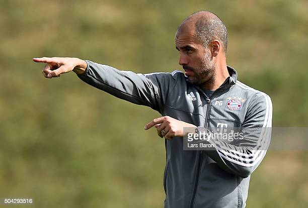 Head coach Josep Guardiola gestures during a training session at day five of the Bayern Muenchen training camp at Aspire Academy on January 10 2016...