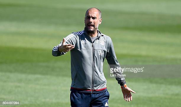 Head coach Josep Guardiola gestures during a training session at day six of the Bayern Muenchen training camp at Aspire Academ on January 11 2016 in...