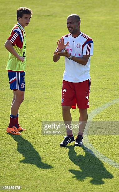 Head coach Josep Guardiola gives instructions to Gianluca Gaudino during a Bayern Muenchen training session at day six of the Audi Summer Tour USA...
