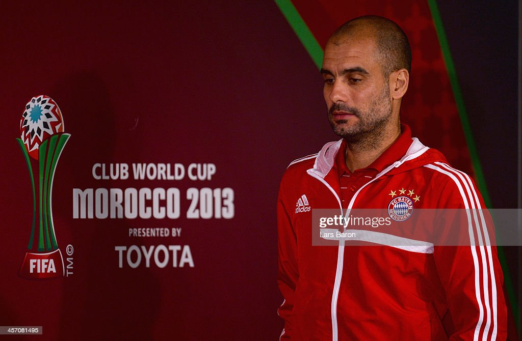 Head coach <a gi-track='captionPersonalityLinkClicked' href=/galleries/search?phrase=Josep+Guardiola&family=editorial&specificpeople=2088964 ng-click='$event.stopPropagation()'>Josep Guardiola</a> looks on during a Bayern Muenchen press conference for the FIFA Club World Cup at Agadir Stadium on December 16, 2013 in Agadir, Morocco.