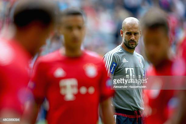 Head coach Josep Guardiola looks on during a FC Bayern Muenchen training session after the FC Bayern Muenchen season opening and team presentation at...
