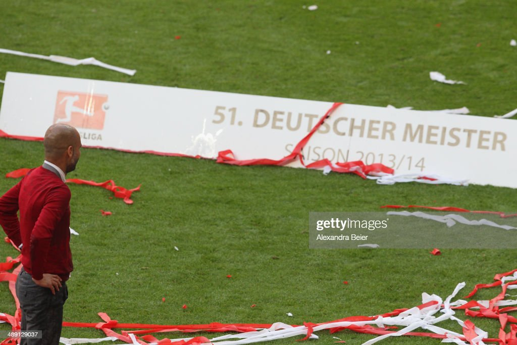 Head coach Josep Guardiola of Bayern Muenchen looks on to celebrate winning the German Championship after the Bundesliga match between FC Bayern Muenchen and VfB Stuttgart at Allianz Arena on May 10, 2014 in Munich, Germany.