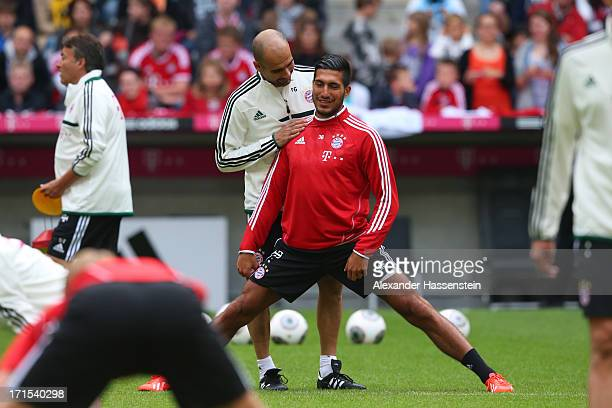 Head coach Josep Guardiola of Bayern Muenchen talks to Emre Can during a training session at Allianz Arena on June 26 2013 in Munich Germany