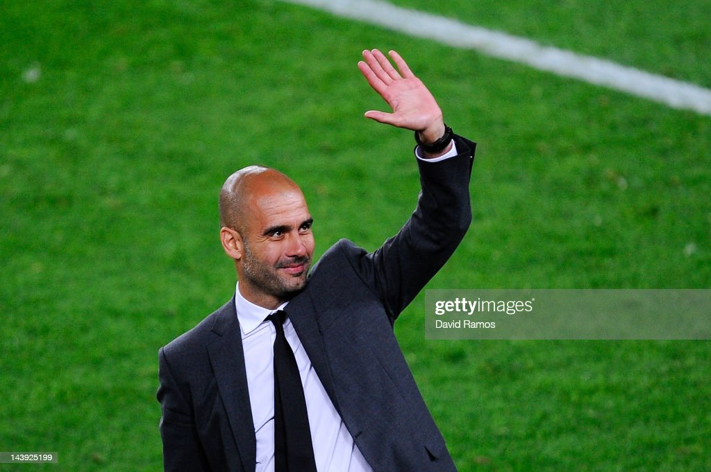 Head coach <a gi-track='captionPersonalityLinkClicked' href=/galleries/search?phrase=Josep+Guardiola&family=editorial&specificpeople=2088964 ng-click='$event.stopPropagation()'>Josep Guardiola</a> of FC Barcelona acknowledge the fans at the end of the La Liga match between FC Barcelona and RCD Espanyol at Camp Nou on May 5, 2012 in Barcelona, Spain. This is Guardiola's last match.