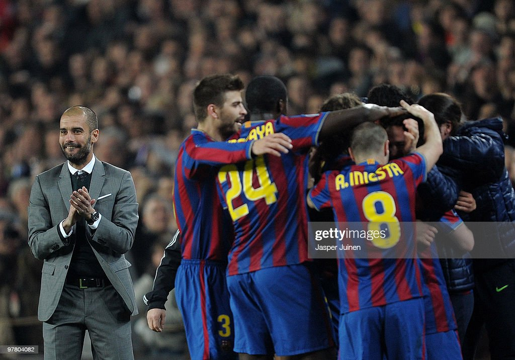 Head coach Josep Guardiola (L) of FC Barcelona celebrates alongside his players after Lionel Messi scored Barcelona's third goal during the UEFA Champions League round of sixteen second leg match between FC Barcelona and VfB Stuttgart at the Camp Nou stadium on March 17, 2010 in Barcelona, Spain. Barcelona won the match 4-0.