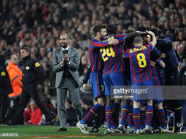 Head coach Josep Guardiola of FC Barcelona celebrates alongside his players after Lionel Messi scored Barcelona's third goal during the UEFA...