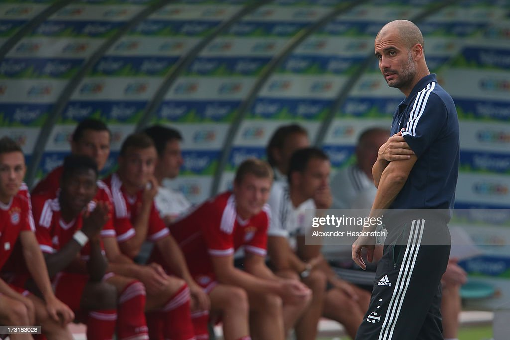 Head coach Josep Guardiola of FC Bayern Muenchen looks on during the friendly match between Brescia Calcio and FC Bayern Muenchen at Campo Sportivo on July 9, 2013 in Arco, Italy.