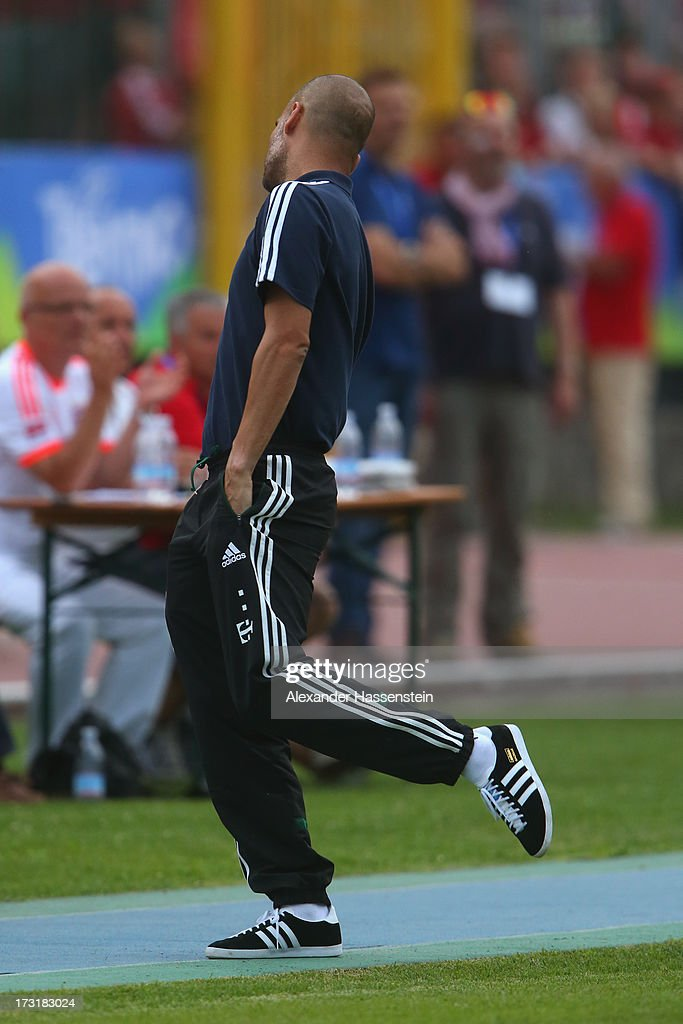 Head coach Josep Guardiola of FC Bayern Muenchen reacts during the friendly match between Brescia Calcio and FC Bayern Muenchen at Campo Sportivo on July 9, 2013 in Arco, Italy.