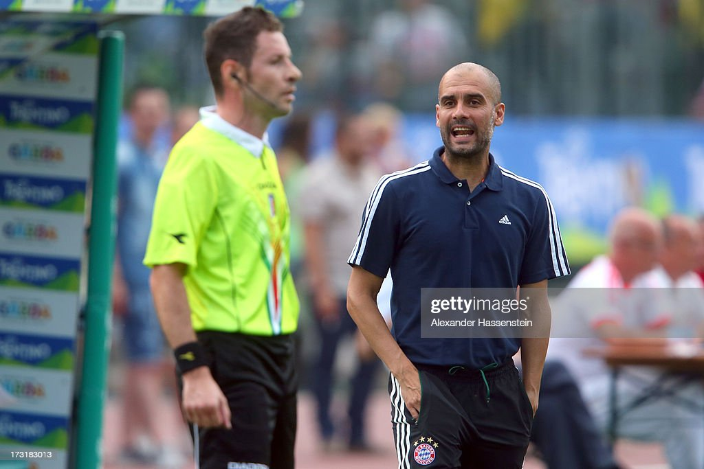 Head coach Josep Guardiola of FC Bayern Muenchen talks to the linesman during the friendly match between Brescia Calcio and FC Bayern Muenchen at Campo Sportivo on July 9, 2013 in Arco, Italy.