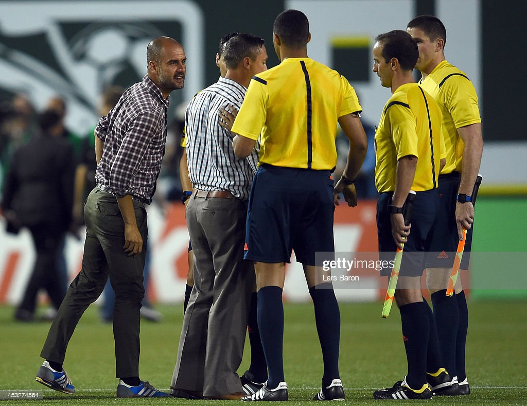 Head coach Josep Guardiola of Muenchen argues with referee Jair Marrufo during the MLS All-Star game between the MLS All-Stars and FC Bayern Muenchen at Providence Park on August 6, 2014 in Portland, Oregon.
