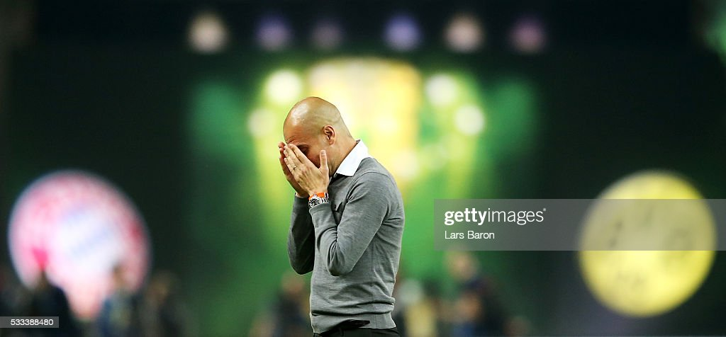 Head coach Josep Guardiola of Muenchen cries after winning during the DFB Cup Final 2016 between Bayern Muenchen and Borussia Dortmund at Olympiastadion on May 21, 2016 in Berlin, Germany.