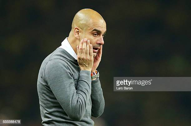 Head coach Josep Guardiola of Muenchen cries after winning the DFB Cup Final 2016 between Bayern Muenchen and Borussia Dortmund at Olympiastadion on...