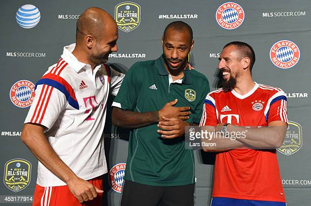 Head coach Josep Guardiola of Muenchen jokes with Thierry Henry of MLS AllStars and Franck Ribery of Muenchen during a press conference prior to the...