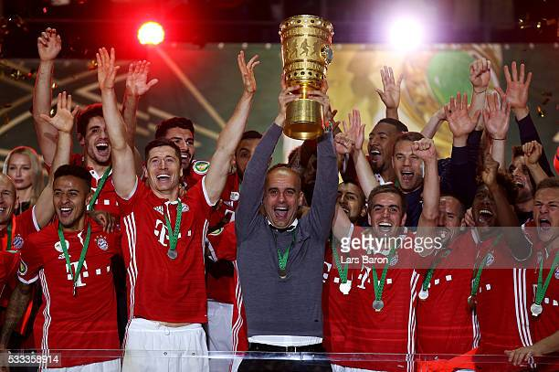 Head coach Josep Guardiola of Muenchen lifts the trophy after winning the DFB Cup Final 2016 between Bayern Muenchen and Borussia Dortmund at...