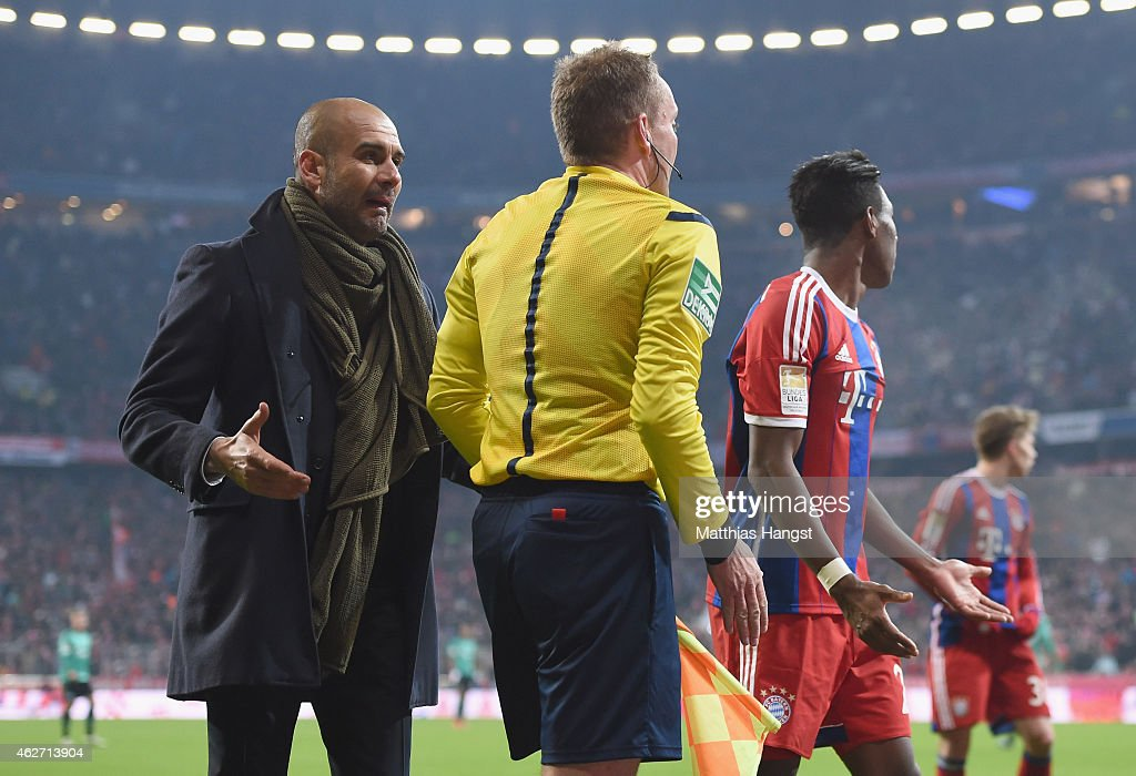 Head coach <a gi-track='captionPersonalityLinkClicked' href=/galleries/search?phrase=Josep+Guardiola&family=editorial&specificpeople=2088964 ng-click='$event.stopPropagation()'>Josep Guardiola</a> of Muenchen reacts to assistent referee Markus Haecker during the Bundesliga match between FC Bayern Muenchen and FC Schalke 04 at Allianz Arena on February 3, 2015 in Munich, Germany.
