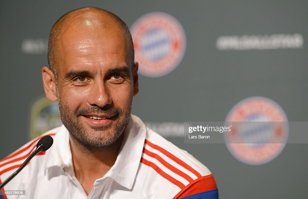Head coach <a gi-track='captionPersonalityLinkClicked' href=/galleries/search?phrase=Josep+Guardiola&family=editorial&specificpeople=2088964 ng-click='$event.stopPropagation()'>Josep Guardiola</a> of Muenchen smiles during a press conference prior to the friendly match between the MLS Allstars and FC Bayern Muenchen at day six of the Audi Summer Tour USA 2014 on August 4, 2014 in Portland, United States.
