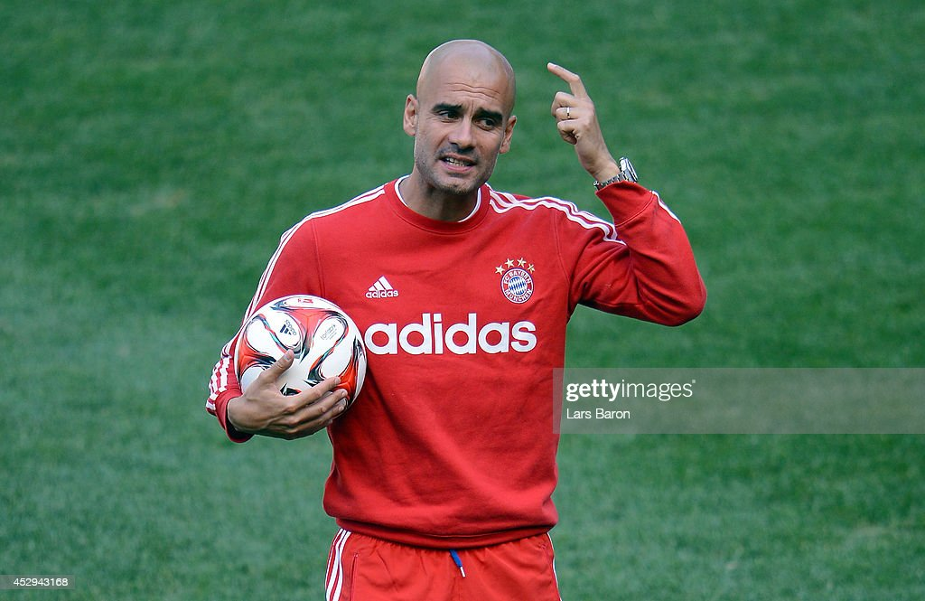 Head coach <a gi-track='captionPersonalityLinkClicked' href=/galleries/search?phrase=Josep+Guardiola&family=editorial&specificpeople=2088964 ng-click='$event.stopPropagation()'>Josep Guardiola</a> reacts during a training session at day one of the Audi Summer Tour 2014 at Red Bull Arena on July 30, 2014 in New Jersey, United States.