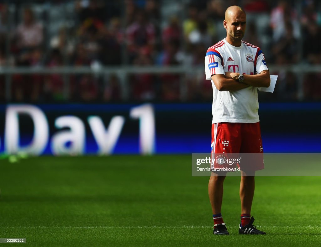 Head coach <a gi-track='captionPersonalityLinkClicked' href=/galleries/search?phrase=Josep+Guardiola&family=editorial&specificpeople=2088964 ng-click='$event.stopPropagation()'>Josep Guardiola</a> reacts during the FC Bayern Muenchen Season Opening event at Allianz Arena on August 9, 2014 in Munich, Germany.