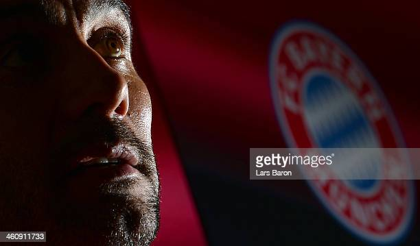 Head coach Josep Guardiola smiles during a press conference at day 2 of the Bayern Muenchen training camp at ASPIRE Academy for Sports Excellence on...