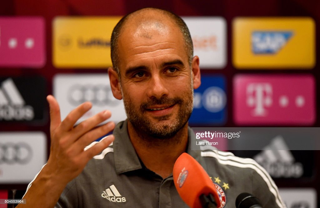 Head coach <a gi-track='captionPersonalityLinkClicked' href=/galleries/search?phrase=Josep+Guardiola&family=editorial&specificpeople=2088964 ng-click='$event.stopPropagation()'>Josep Guardiola</a> smiles during a press conference at day six of the Bayern Muenchen training camp at Aspire Academ on January 11, 2016 in Doha, Qatar.