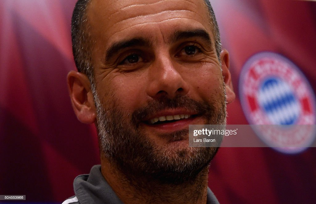 Head coach Josep Guardiola smiles during a press conference at day six of the Bayern Muenchen training camp at Aspire Academ on January 11, 2016 in Doha, Qatar.